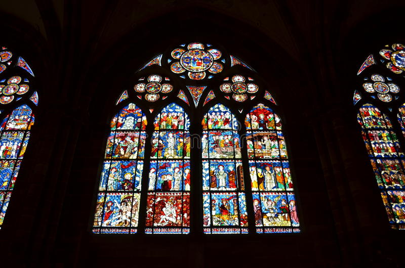 Stained glass window of the Strasbourg Cathedral in France stock images