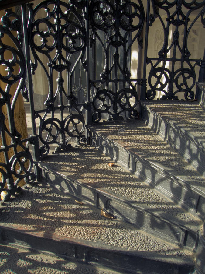 Medieval staircase with wrought railings royalty free stock images