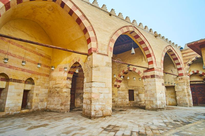 Medieval stone arcade of Aqsunqur Blue Mosque of Cairo, Egypt. The medieval stone arcade of Aqsunqur Blue Mosque with Ablaq style striped stone decoration of stock photos