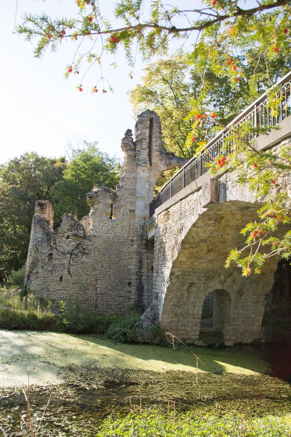Medieval stone bridge over the river in Blanquefort France stock photography