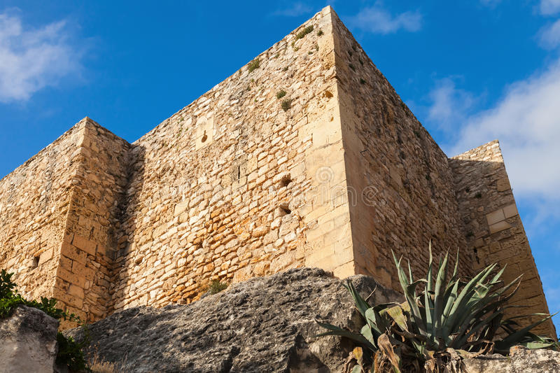 Medieval stone castle on the rock. Calafell, Spain. Medieval stone castle on the rock. Main landmark of Calafell, Spain stock image