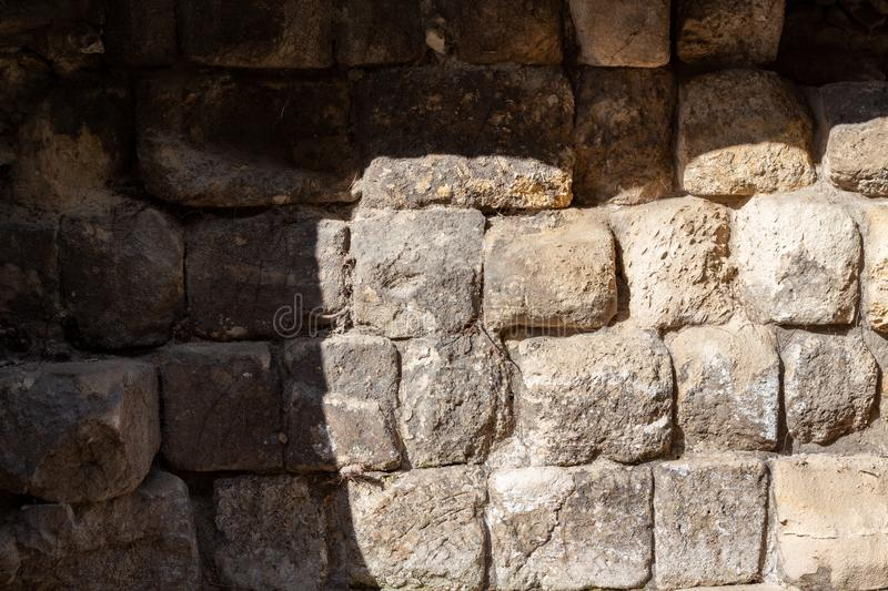 Medieval stone city wall of Sopron, Hungary. Big pieces of ancient stones. The wall is partly in shade stock photography