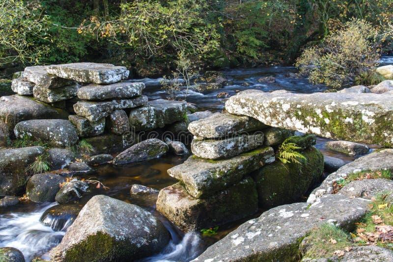 Medieval stone Clapper Bridge, Dartmoor England. Partially collapsed ancient stone clapper bridge. Dartmeet, Dartmoor National Park, Devon, England, United royalty free stock photos