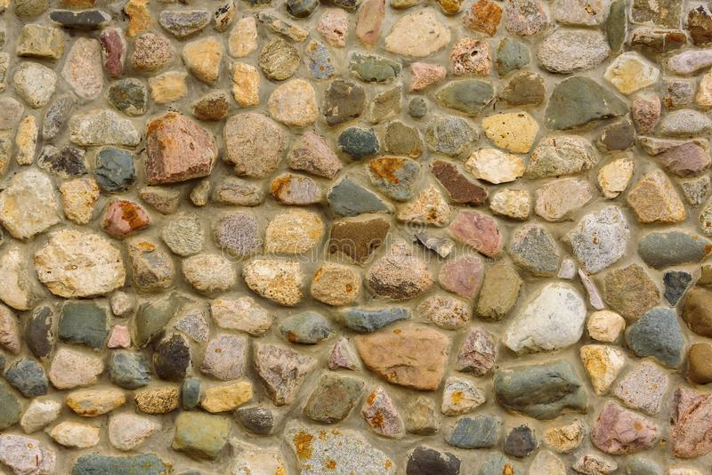 Medieval stone wall. Background made of natural solid stone. Medieval stone wall. Background made of natural solid stone royalty free stock images