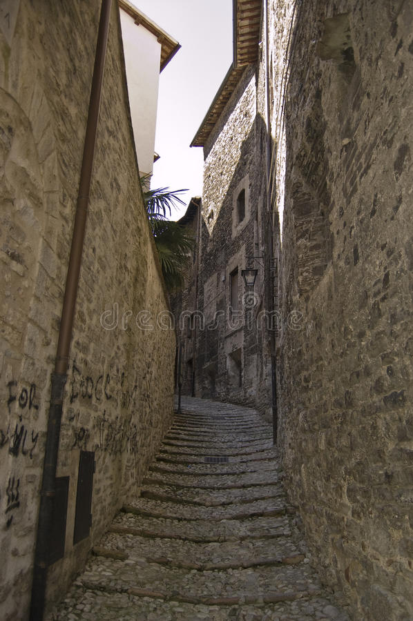 Medieval street. Narrow street in Spoleto, medieval small town in Italy royalty free stock images