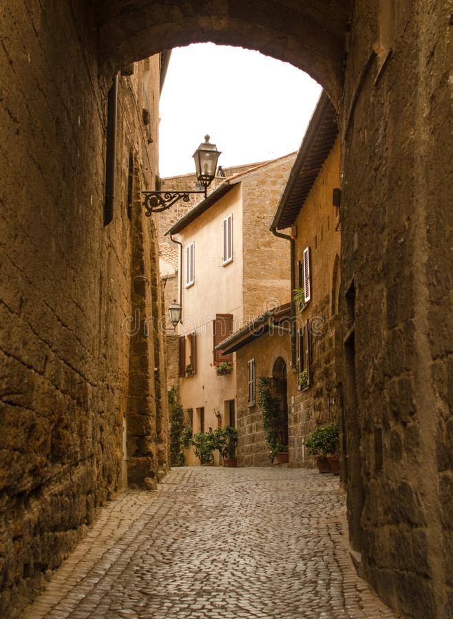 Medieval street with arc by Orvieto stock photography
