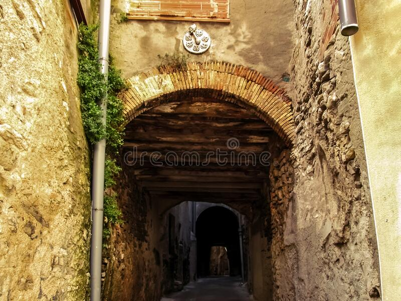 Medieval street in the form of a tunnel in the historical part of the Cervera town in Catalonia Lleida, Spain. Narrow low arched. Passage between ancient walls stock photo