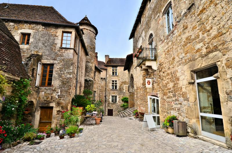 Medieval street the village of Carennac, France. Picturesque medieval street the beautiful Dordogne village of Carennac, France royalty free stock photo