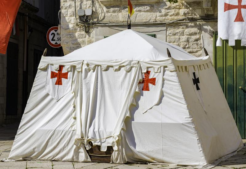 Medieval tent with template cross mounted. During a historical reenactment stock photo