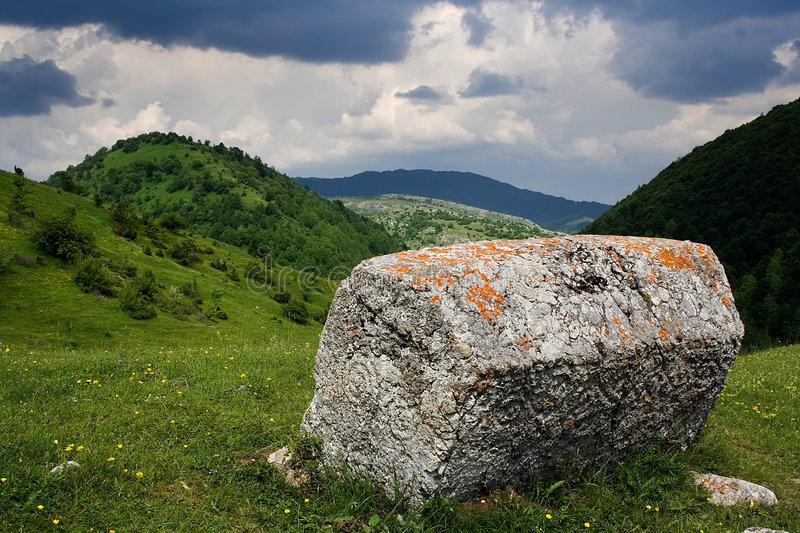 Medieval tombstone. A medieval tombstone in the bosnian mountains, Stecak stock images