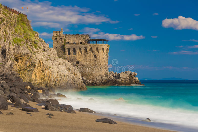 Medieval tower on the coast of Maiori town, Amalfi coast, Campania region, Italy. Medieval tower on the coast of Maiori town, blurred sea waves effect, Amalfi royalty free stock photography