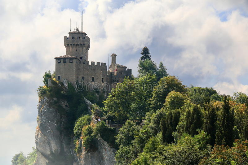 Medieval tower De La Fratta or Cesta in San Marino. Beautiful view of the medieval tower De La Fratta or Cesta located on the highest of Monte Titano`s summits stock photo