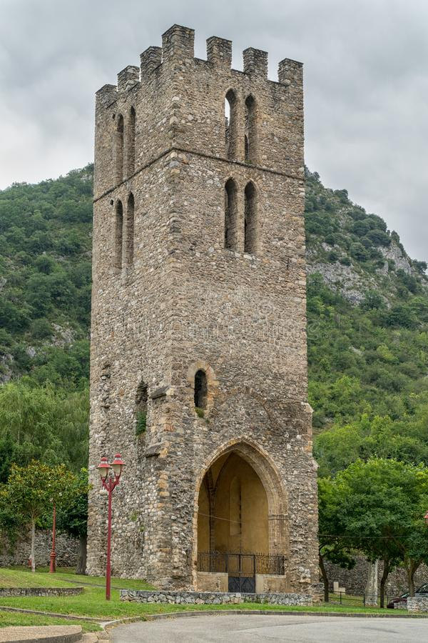 A medieval tower in Foix. This medieval tower in Foix is isolated and unobstructed in a park of the city stock photo