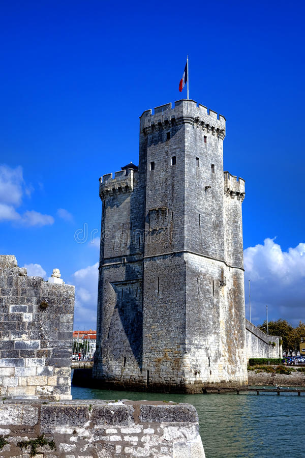 Medieval Tower in Old Port of La Rochelle France. Tour Saint Nicolas middle ages fortress and medieval harbor entrance tower fortification as fortified entrance stock photos