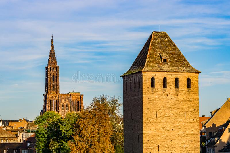 Medieval Tower of the Ponts Couverts, historic Petite France downtown district of Strasbourg, and the cathedral in the background. France stock photos