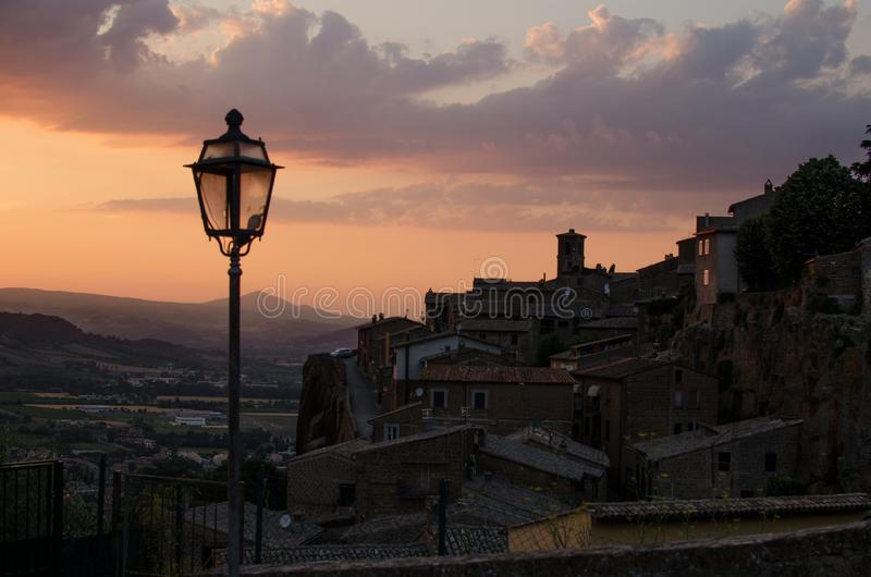 Medieval town and streetlamp by sunset stock photos