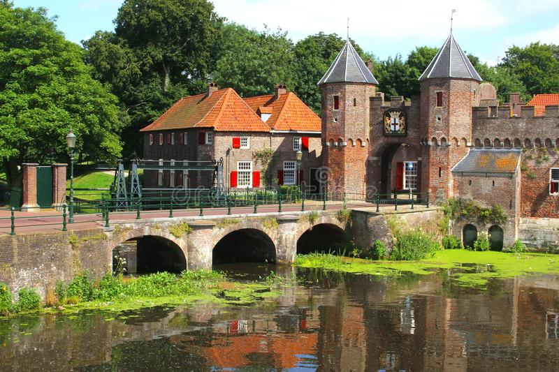 Medieval town wall Koppelpoort and the Eem river in Amersfoort, Netherlands royalty free stock photography