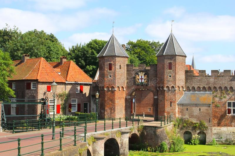 Medieval town wall in fortress city of Amersfoort, Netherlands. Medieval town wall along the Eem river in Amersfoort in the Netherlands; Amersfoort is a tourist stock image