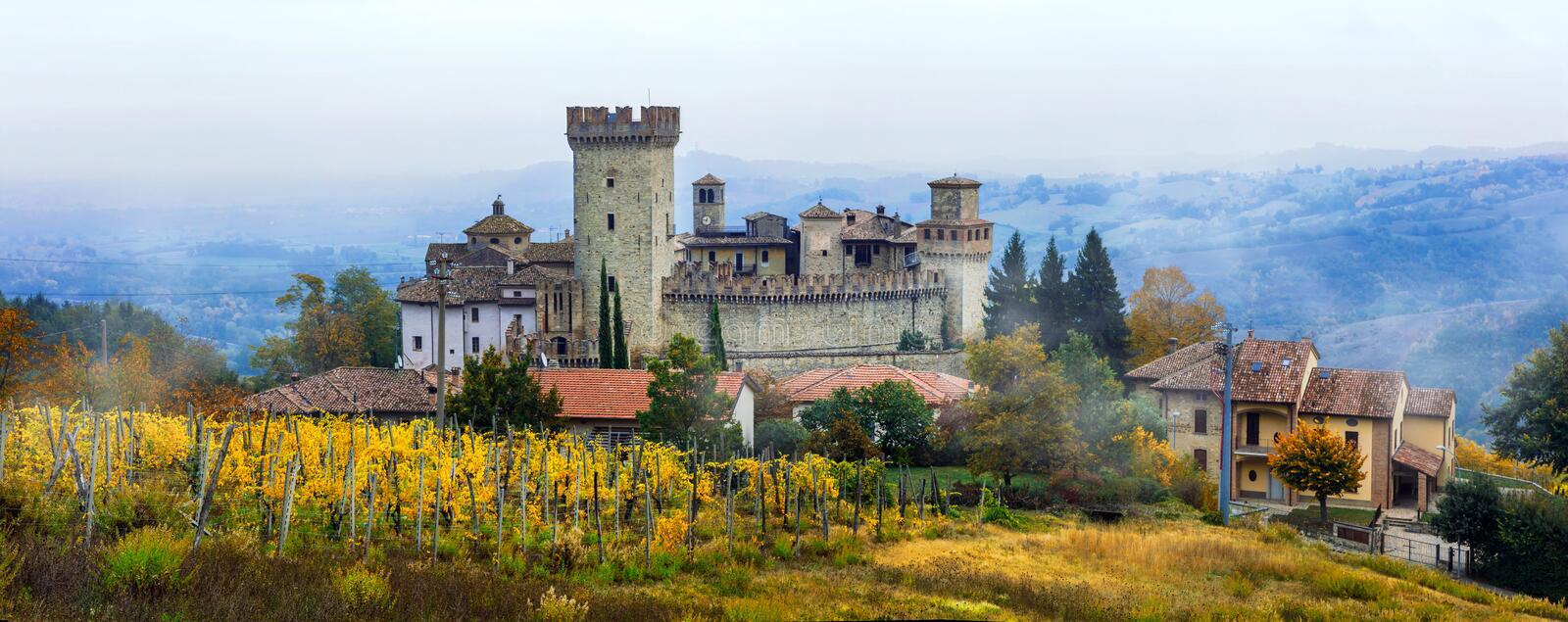 Medieval towns and castles of Italy -Vigoleno with vineyards in. Impressive Vigoleno castle,view with vineyards,Emilia Romagna,Italy stock photography