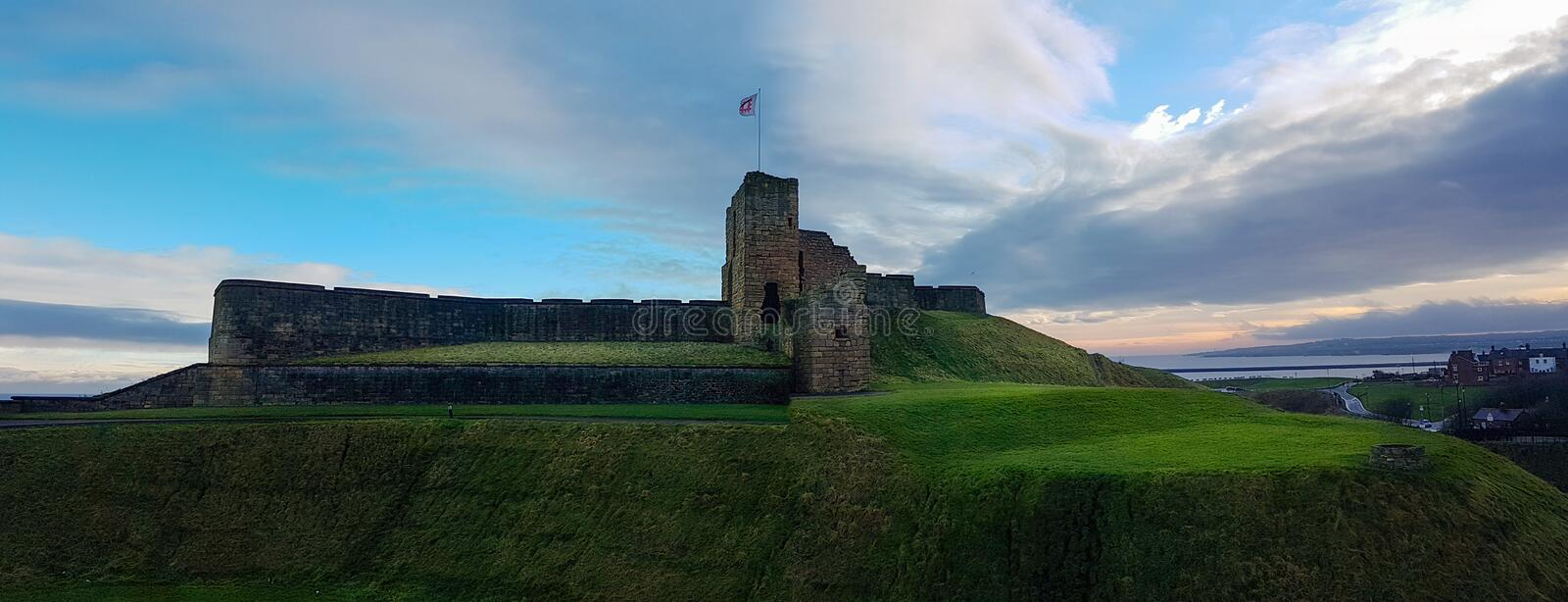 Medieval Tynemouth Priory and Castle ruins panorama, United King. Panoramic view of the ruins of the medieval Tynemouth Priory and Castle in the United Kingdom royalty free stock image
