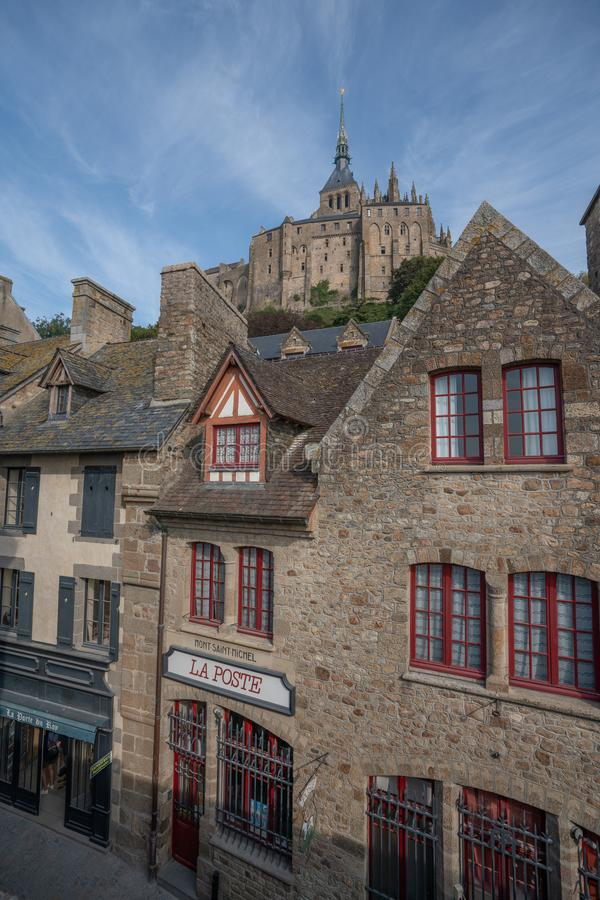 Medieval village buildings on the Mont St Michel with the abbey in the background. stock photo