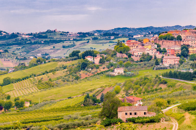 Medieval village and cultivated fields in the hills stock photo