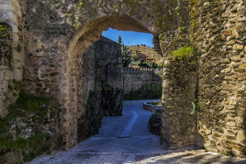 Medieval walled city. Arches and stone walls. royalty free stock images