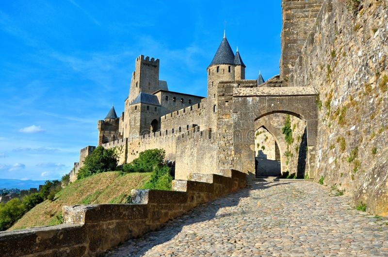 Medieval walls of Carcassonne, France under blue skies stock image