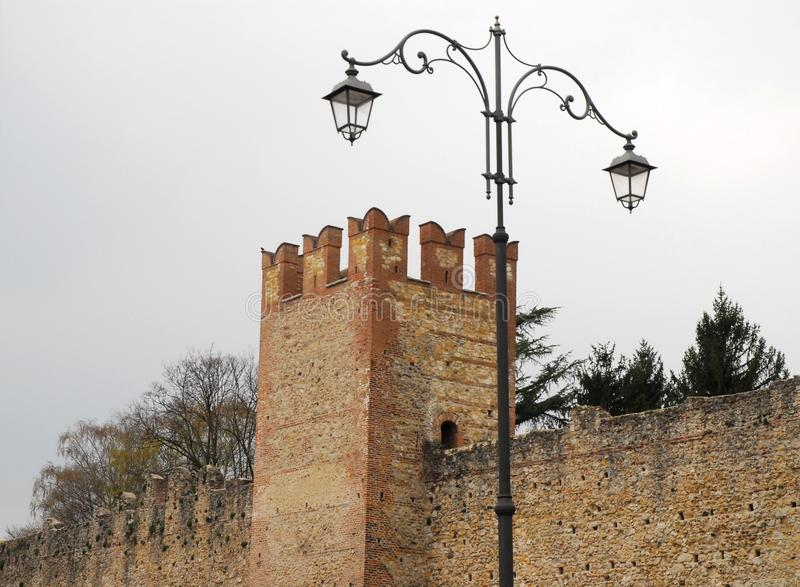Medieval walls and a lamppost in Marostica in Vicenza in Veneto (Italy). Photo made to Marostica's medieval walls in the province of Vicenza in Veneto (Italy) royalty free stock photos