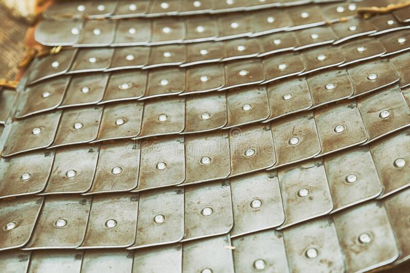 Medieval warrior lamellar armor made of iron plates silver military background stock image