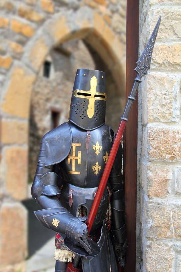 Medieval warrior soldier metal protective wear. Swordman royalty free stock images