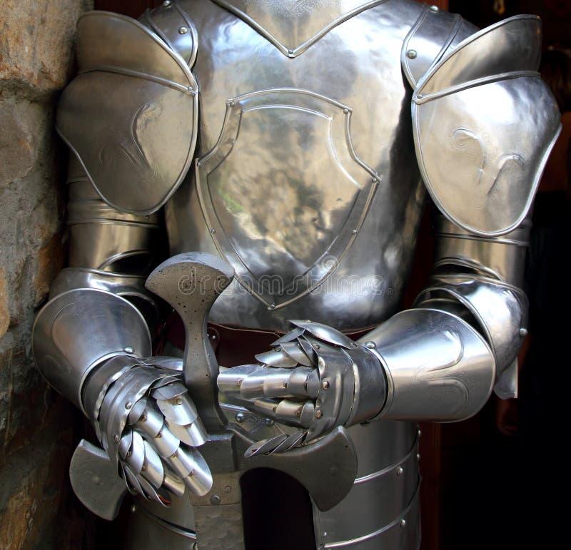 Medieval warrior soldier metal protective wear. Swordman stock image