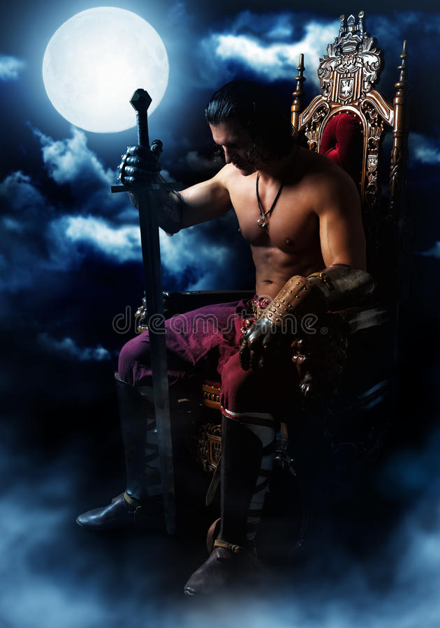 Medieval warrior on the throne on background of the moon stock photography
