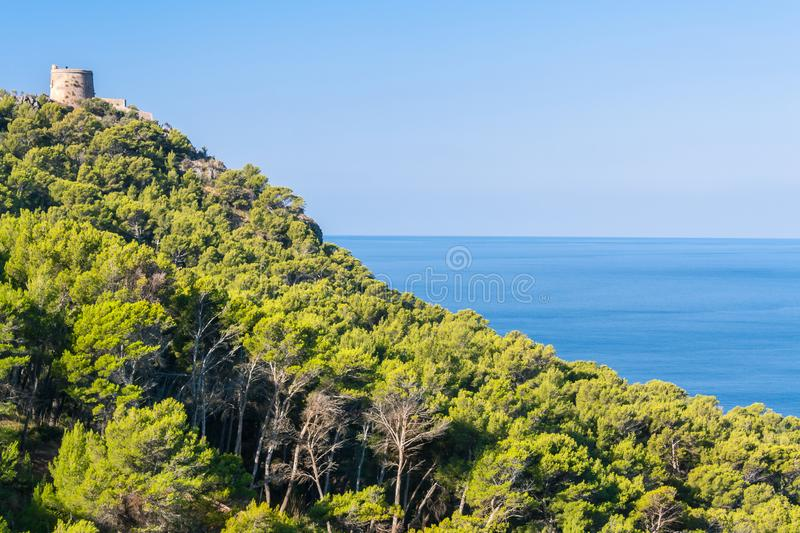 Medieval watchtower above Mediterranean Sea on Majorca island royalty free stock photo