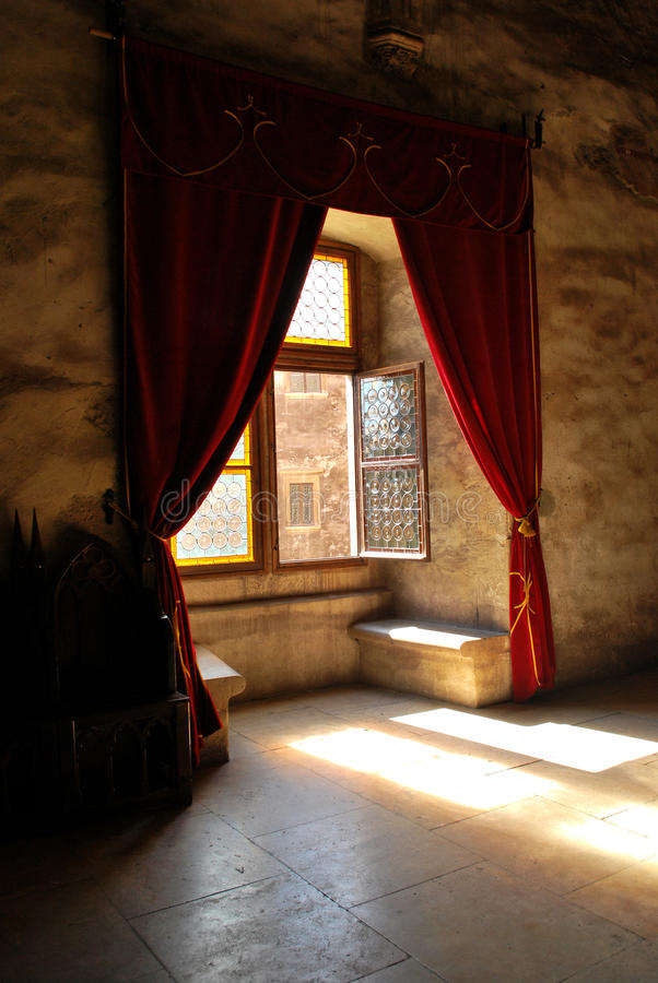 Medieval window. Window at Hunyad Castle. The castle is a relic of the Hunyadi dynasty. In 1409, the castle was given to John Hunyadi's father, Voyk, by royalty free stock images