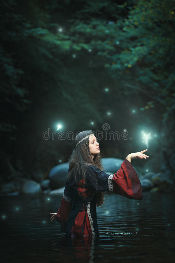 Medieval woman in fairy stream stock photo