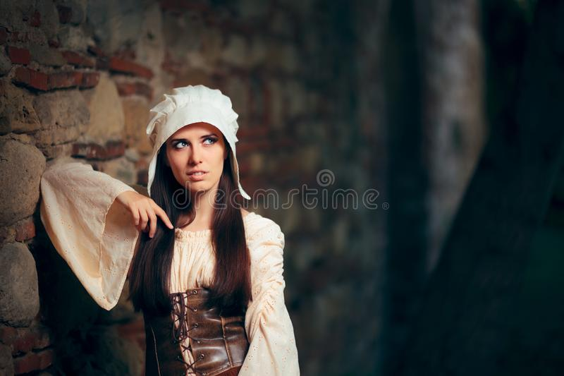 Medieval Woman in Historical Costume Wearing Corset Dress and Bonnet stock photos
