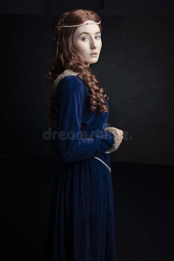 Free Medieval Woman In A Blue Velvet Dress Royalty Free Stock Images - 159064519