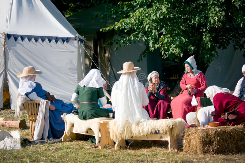 Medieval women chatting stock images