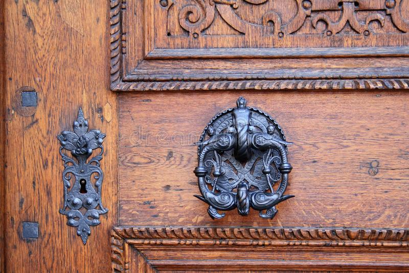 Medieval wooden door of the cathedral in Prague Castle stock images