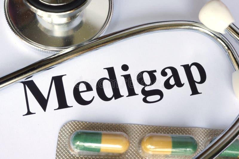Medigap που γράφεται σε χαρτί στοκ φωτογραφία με δικαίωμα ελεύθερης χρήσης