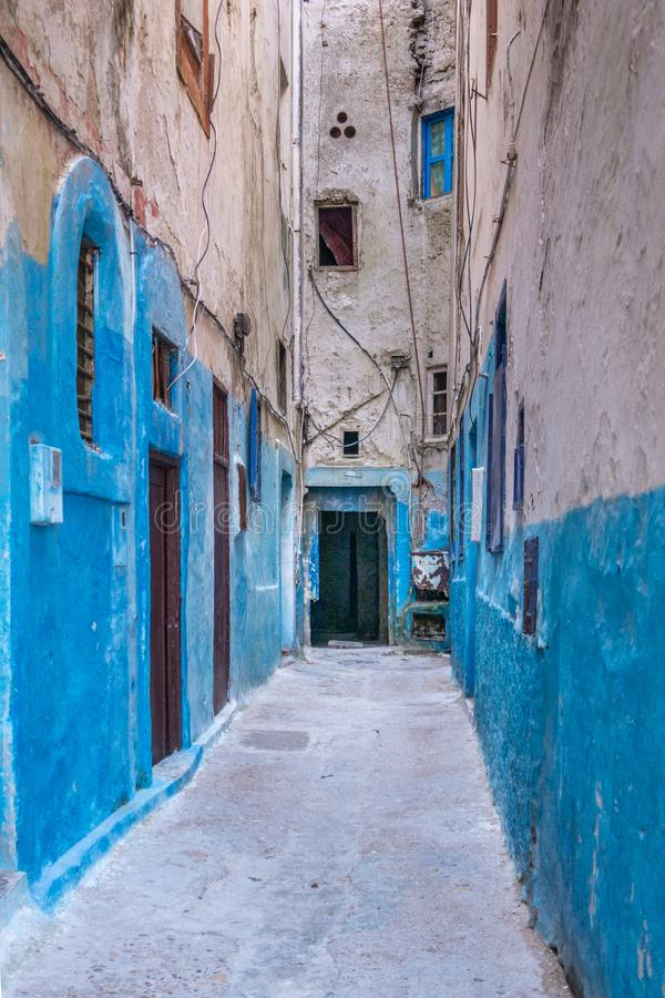 Medina of Essaouira. A small street in the medina of Essaouira in Morocco. The bottom of the walls is painted in blue royalty free stock photos