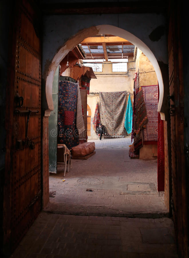 The medina of Fez souk. The souk of the Medina of Fez in Morocco. More than 9000 streets enclosed by medieval walls conform the medina where more than 300000 stock image