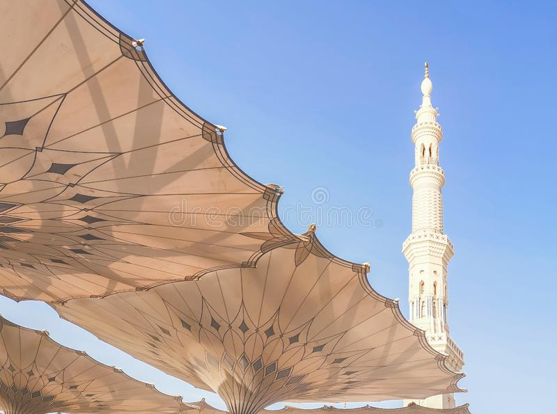Exterior of Nabawi Mosque building and electronic umbrella in Medina Madinah. Selective focus stock photography