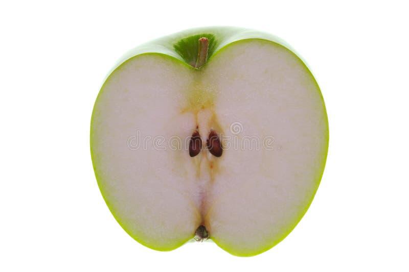 Medio Apple puesto a contraluz imagenes de archivo