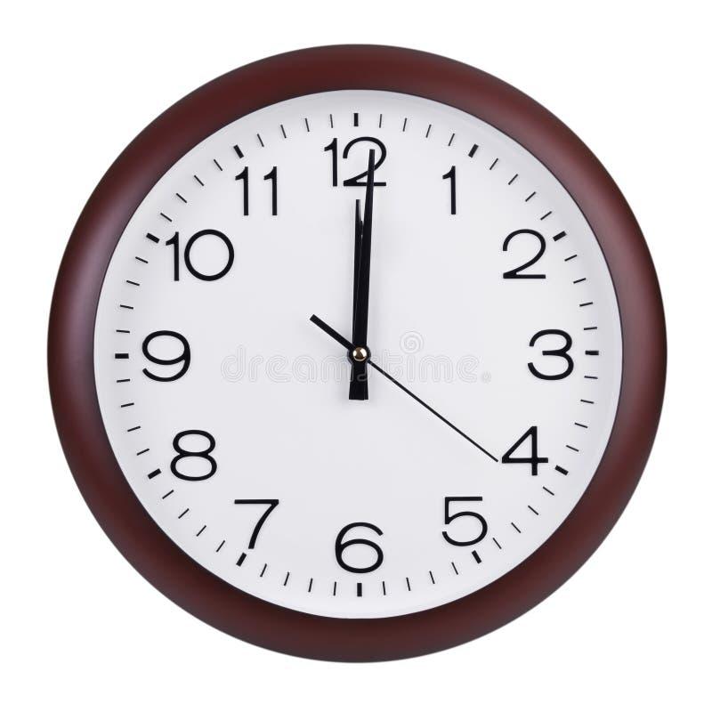 Mediodía en el dial del reloj redondo imágenes de archivo libres de regalías