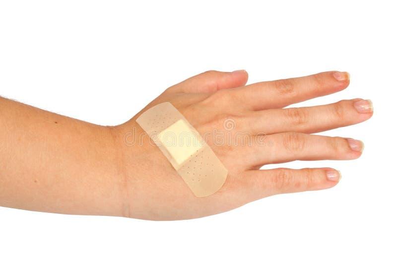 medisch pleister of flard op geïsoleerde hand royalty-vrije stock afbeelding