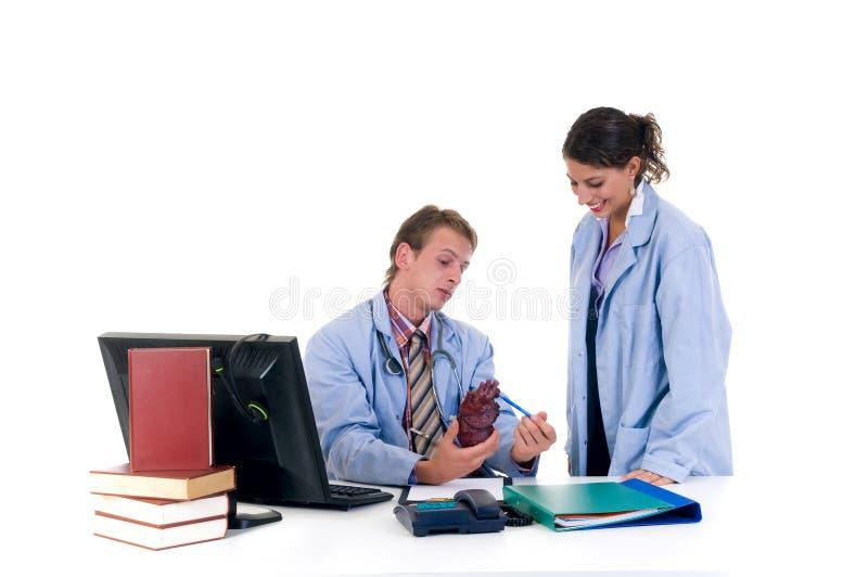 Medisch team, cardioloog stock afbeeldingen