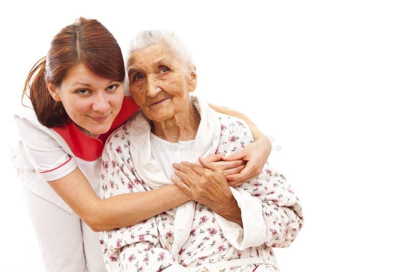 Medische behandeling voor een oude vrouw stock afbeelding