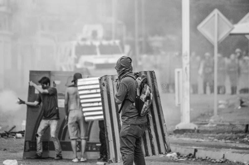 Medische studenten van UCLA-protesten tijdens Venezolaanse Guarimbas stock afbeeldingen